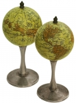 A Small Pair Of Desktop Globes On Silver-Plated Stands