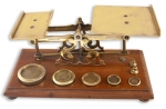Brass Postal Scales with 7 weights on a Mahogany Base
