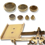 Brass Postal Scales with 7 weights on a Mahogany Base - click to enlarge.