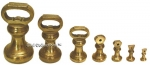 Set of 7 English Brass Bell Shaped Weights.